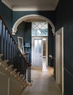 Inspiration for a classic contrast in a traditional hallway.  Walls painted in Inchyra Blue with the woodwork and inner front door in Strong White