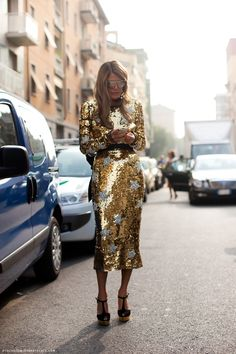 ANNA DELLO RUSSO WENT STAR-SPANGLED IN A TEA-LENGTH DOLCE & GABBANA SEQUIN DRESS AND YSL WEDGES DURING SPRING 2012 MILAN FASHION WEEK