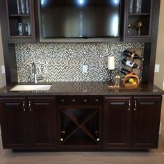 Wet bar with tv above