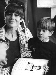The actress Audrey Hepburn photographed with her son Sean H. Ferrer by Elio Sorci at a cafe in Rome (Italy), in March 1968