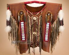 This is an authentic decorative Native American war shirt, handcrafted by the…