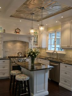 gorgeous kitchen- love the tins on the ceiling.  Maybe could do that then put wood molding around it.