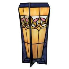 @Overstock - Tiffany Style Bronze Table Lamp - This beautiful Tiffany style table lamp brings charm to any room. Made from stained art glass and bronze, it measures 10 inches high and 4 inches in diameter. Designed for indoor use, the lamp requires a 60-watt bulb and is ideal for most rooms.  http://www.overstock.com/Home-Garden/Tiffany-Style-Bronze-Table-Lamp/6749302/product.html?CID=214117 $35.09