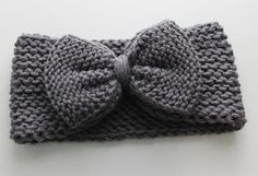 Adult sized gray ear warmer adorned with a bow. Super cute and your ears will…