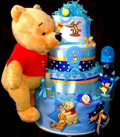 Who say Winnie the Pooh is just for baby girls? .. Pooh looks awesome, doesn't matter if it is for baby girl or baby boy ... what do you thing? ...Blue Winnie the Pooh diaper cake!