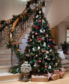 Christmas tree and garlands I styled in a stunning entrance hall in a country house in Oxfordshire www.aji.co.uk