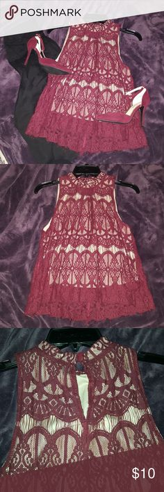Halter top Lace halter top with a nude halter underneath.   Color: wine/burgundy  Love Fire brand from Marshalls love fire Tops Blouses