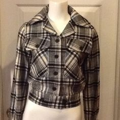 Vintage Plaid Cropped Jacket A neat vintage find. Jacket is biker style . Plaid fabric. Wool blend, pointed colors,2 deep button pockets on front, tight buttoned band across bottom that buttons and buttons on cuff. Excellent condition . Plaid is trending this season . Trousers Up Jackets & Coats Utility Jackets
