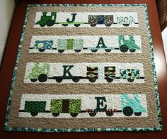 "A Quilt for Jake ~ This little quilt (31"" x 30"") doesn't have a pattern...just an idea for a train quilt w a name!"