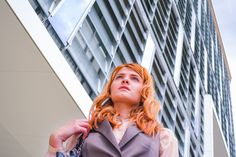 Woman in Grey Blazer Low Angle Photography Near Building  Free Stock Photo