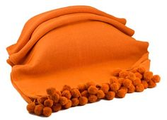 """#RGPM01-BO Orange Pom Pom Throw      100% Cotton Woven Throw with jumbo ball tassel fringe. Available in an array of trend-setting colors.    Color: Orange  Size: 50"""" x 60""""  Price:$45.00"""