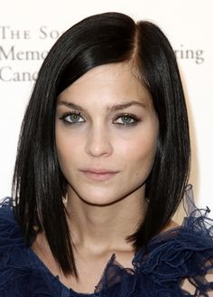 Dark glossy straight shoulder-skimming long bob with side part