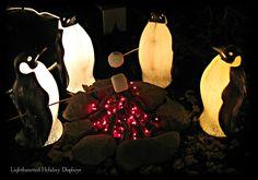 Penguins roasting marshmallows.