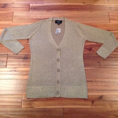 """Sparkly gold cardigan with long sleeves ****HOLIDAY SALE**** Great for your next holiday party!! Festive sparkly gold cardigan with buttons which is on the longer side. Can be considered """"boyfriend style"""". Brand new. Never worn. K Dash by Kardashian Sweaters Cardigans"""