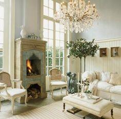 Beautiful Swedish(?) fireplace.  Love the color scheme.