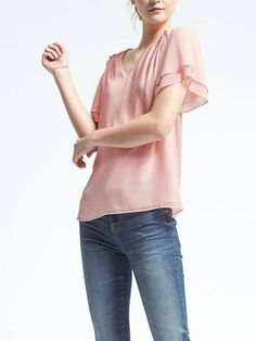 Love this color and the sleeves!  The fabric looks a bit sheer though.