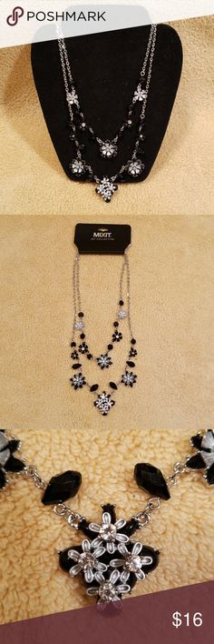 Mixit Jet Collection Black & Silver Necklace Lovely black and silver double strand floral inspired necklace from Mixit Jet Collection.   This necklace measures approximately 18 inches for the longer strand an 16 inches for the shorter strand.   Brand new with tags. Mixit Jewelry Necklaces