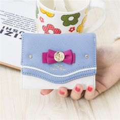 Features: Beautiful Sailor Moon design Short Wallets are a must for any Sailor Moon lovers! Compact trifold wallet that's made easy to carry but still packs a large capacity for cards, coins and bills. Perfect for girls on the go! Adorned with matching bow in the style that we all know and love! Size: About 10 cm x 2.5 cm x 8 cm. Clutch Mini, Clutch Purse, Purse Wallet, Black Wallet, Small Wallet, Makeup Geek Eyeshadow, Kawaii Bags, Cute Wallets, Coin Bag