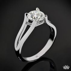 """Sleek and stylish, the """"Katie"""" Solitaire Engagement Ring definitely stands out of the pack. The beautiful split shank design creates four clawed prongs that ensure your diamond is completely secure. This is a sister design to our"""