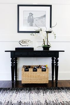 """There's nothing routine about a busy lifestyle. With modular storage and organizational solutions, our Wyatt Collection helps keep your household running smoothly. Each component is crafted using natural materials like mango wood and leather, and mixes in easily with any room's decor. The rolling cart is supremely versatile, easily moveable and with plenty of storage space. KEY PRODUCT POINTS 16.25"""" square, 33.75"""" high Made of mango wood and metal with a powder coat finish. Lid of cart opens…"""