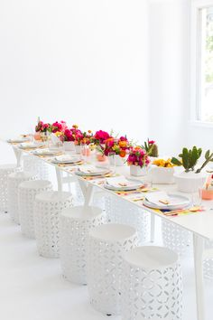 Summer florals will add dimension and color to your crisp white wedding reception decor.