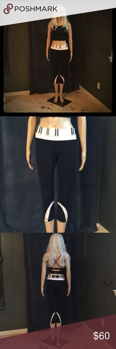 ✨Lululemon Inspire Crop II✨ Lululemon Inspire Crop II. Cool-to-the-touch Luxtreme® fabric is four-way stretch and sweat-wicking—we added LYCRA® fibre for shape. Mesh fabric panels help you let off steam; breathable, lightweight. Color: Black with white stripe at leg, waistband striped black, white, and dark grey. Added zipper in back. Used: like new! Only wore once. ✨✌️✨ lululemon athletica Pants Ankle & Cropped