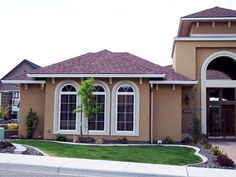 Painted brick home with brown roof...These colors work well ...
