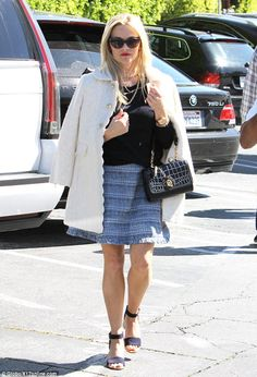 Snazzy star: Reese Witherspoon stepped out in a pretty outfit from Draper James in Brentwo...