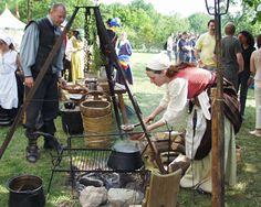 A hungry soldier peeks at the stew cooking in a Thirty Years War camp.