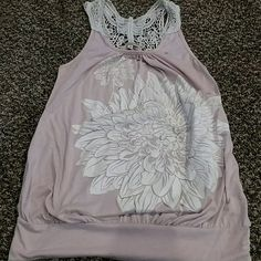 Light pink tank top Top has a big Dahlia decal on the front and lace details on the back. Tops Tank Tops