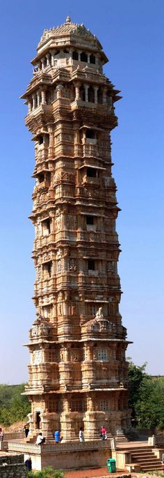 "Vijay Stambha or ""Tower of Victory"" is an imposing structure located in Chittorgarh fort in Rajasthan, India. The slabs in the uppermost story contains genealogy of the rulers of Chittaur from Hamir to Rana Kumbha. The entire tower is covered with architectural ornaments and inscribed images of gods and goddesses, seasons, weapons, musical instruments, etc."