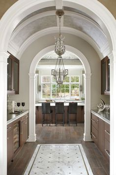 Rhythm Transition-Leads the eye in a gentle, continuous, uninterrupted visual flow from one area to another or object to another. Arches are much smoother, less abrupt, than doorways with square corner. Curved lines are a sign of transition.