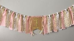 A personal favorite from my Etsy shop https://www.etsy.com/listing/462615458/pink-gold-one-fabric-high-chair-banner
