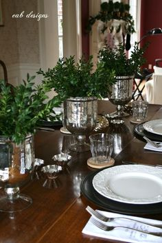 Love the simplicity of boxwood and mercury glass. by EAB Designs: Holiday Decorating