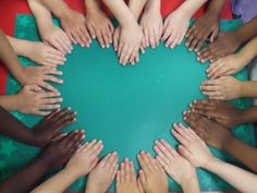 Hands in a heart shape for class photo.