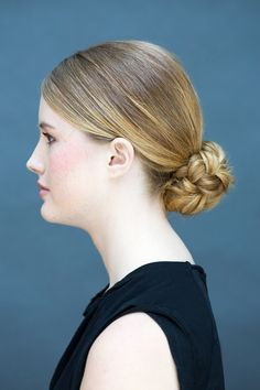 Show off an unexpected twist with this no nonsense braided bun.   - MarieClaire.com