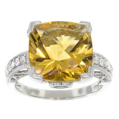 Citrine ring with garnet accents and 1/8 carat total weight of diamonds, in 14K white gold. Gemstone is approximately 12mm square.