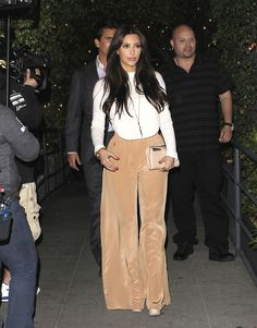 Kim Kardashian shows off a high waisted trouser look