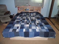 2010. Made for a friend's teenage son.  It is all denim from jeans, including pockets from the jeans on each corner block.  Back is fleece. Heaviest quilt I will ever make!