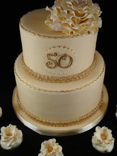 Cream and Gold 50th Wedding Anniversary Cake! with carnations on top instead