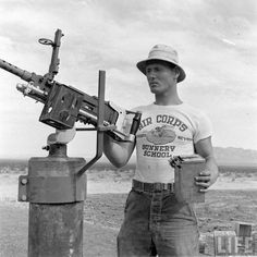 Corporal Alexander Le Gerda of the 853rd Ordnance Company. The 23 year olds job  was to maintain the machine guns, like the .30 caliber Browning in the pic, he also issued student aerial gunners with... Eastman Leather, Shasta Dam, Victory Parade, Engineer Boots, Work Uniforms, Life Magazine, Us Army, Vintage Photos, Vintage Tees