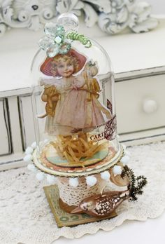 paper doll under glass cloche--this is what I should do with all the Mary Engelbreit ones out of her magazines!