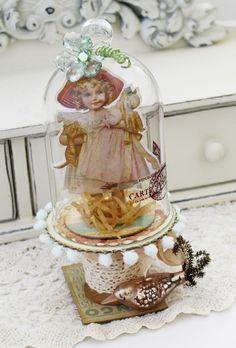 paper doll under glass cloche