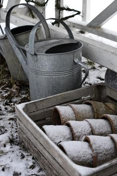 in the frozen garden, watering cans and pots