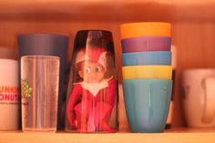 Elf stuck under a glass + lots of other ideas in the Elf on the Shelf Photo Gallery