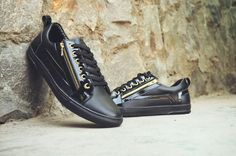 Black is classy! Doc Martin black carvil sneakers made up from faux leather and superior outsole with accessory styled with a chain Sneaker Brands, All Black Sneakers, Men's Shoes, Classy, Chain, Projects, Leather, Accessories, Style