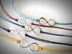 Sterling Infinity bracelet on colored linen from JewelryByMaeBee on Etsy.