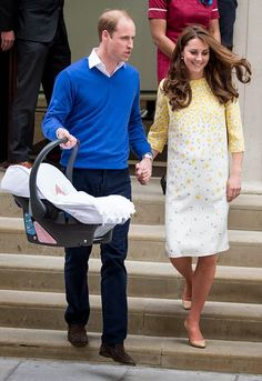 Prince William, Duke of Cambridge and Catherine, Duchess of Cambridge leave hospital with their new baby daughter at St Mary's Hospital on May 2, 2015 in London, England.