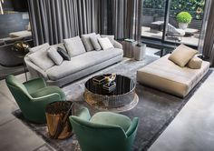 "Grand Jacques sofa and Jacques ""high"" armchair, Lawrence ""Clan"" ottoman, Caulfield ""Gold"" coffee table, Rodolfo Dordoni design. Noor coffee table, Christophe Delcourt design."