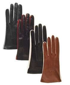Perfect for dress or casual wear throughout the year, these beautiful leather gloves for women are sure to make a lasting impression. The shell is black or brown leather of the best Italian lambskin leather, and contrasting red or white leather is added on the side of the hand and the fourchettes between the fingers. Decorative French stitching (whipstitching) adds to the distinct style, while a silk lining makes the interior as cool as the exterior. These playful, memorable ladies' gloves…